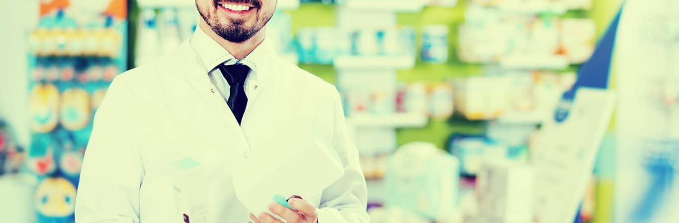 Chemist smiling holding medication