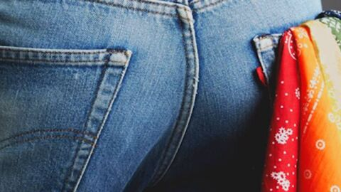 Different coloured handkerchiefs in mans back jeans pocket