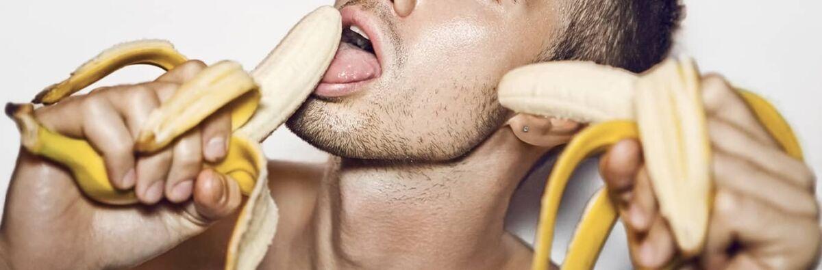 Man eating bananas