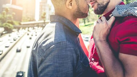 Two men about to kiss
