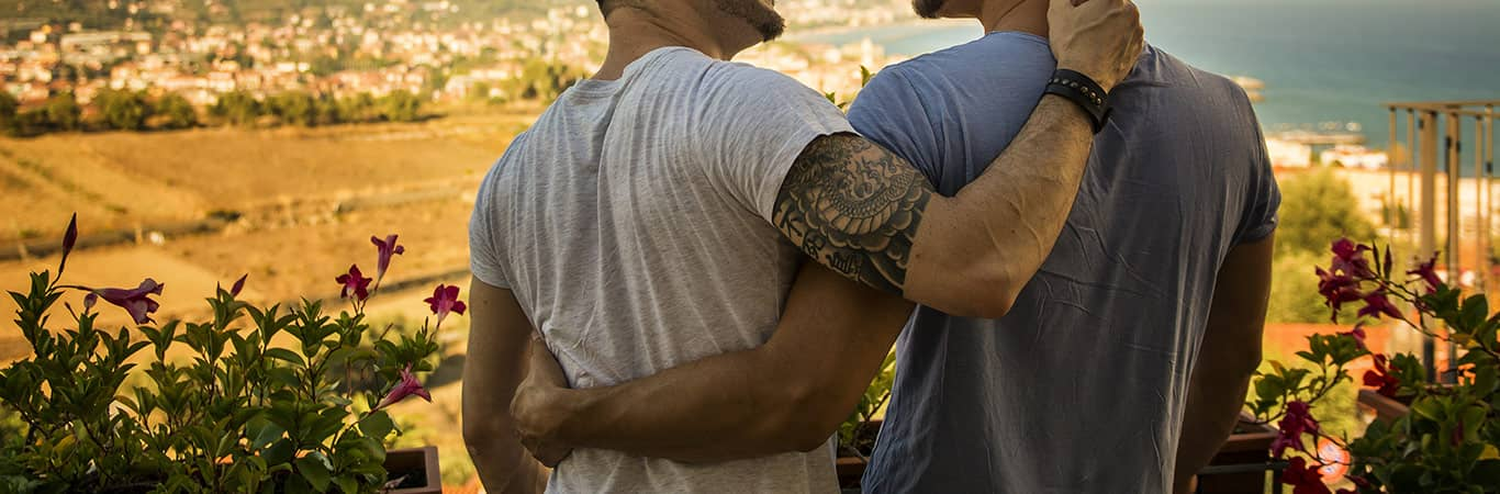 Two men with arms around each other