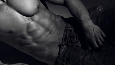 topless gay man lying down in jeans