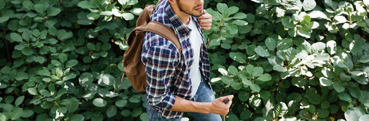 Man-hiking-in-bushes