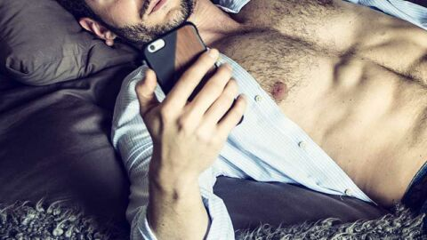 Man-with-open-shirt-on-phone