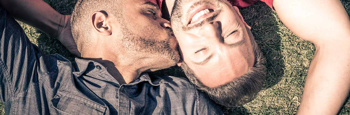 Two men kissing