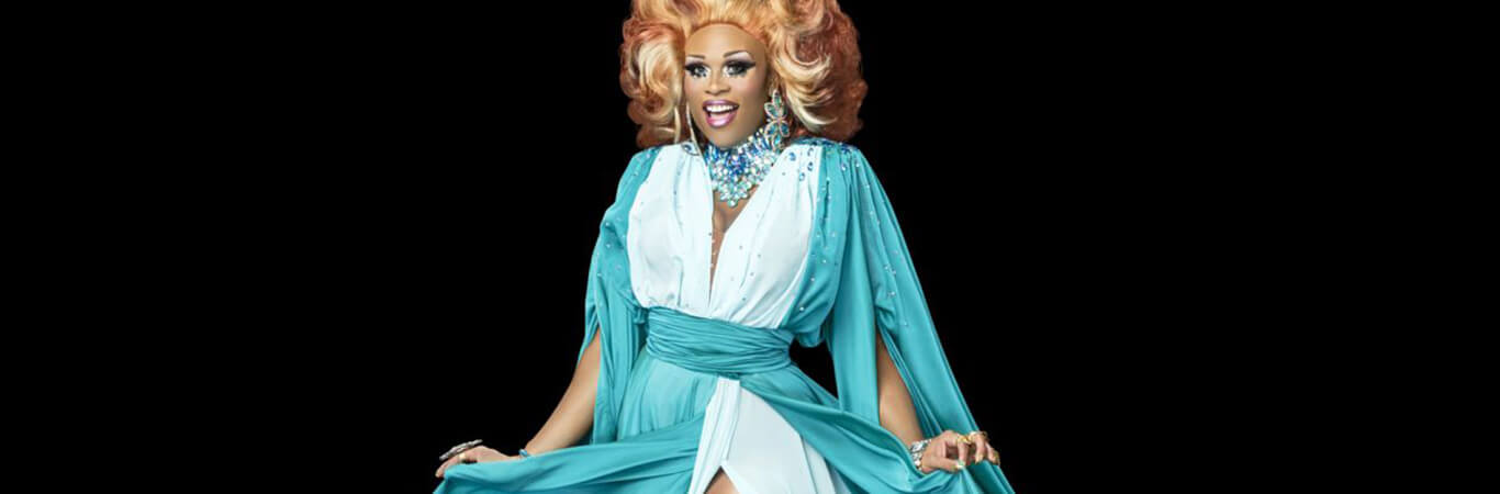 ru paul drag queen in white and blue dress