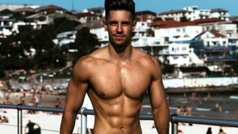 topless muscular ryan greasley on bondi beach
