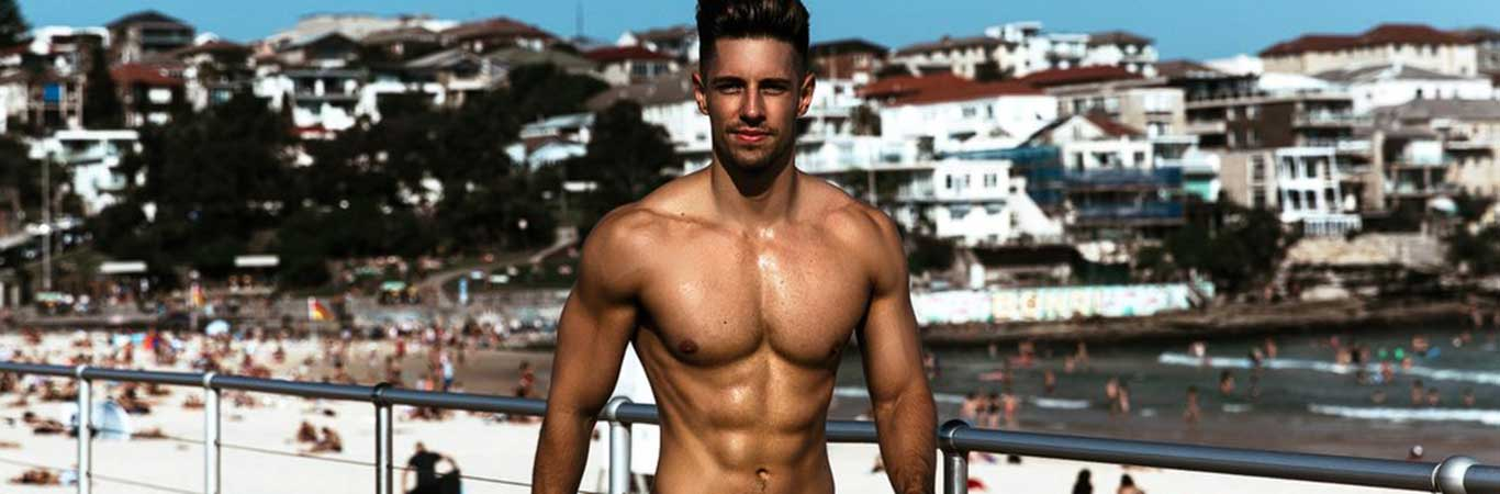 topless muscular ryan greasley on bondi beach
