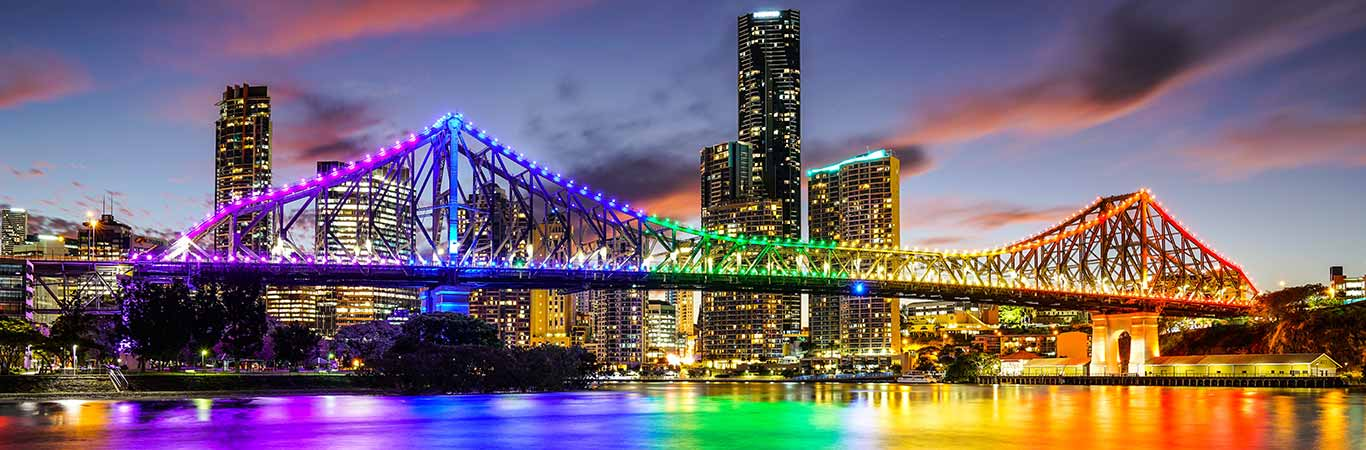 Brisbane bridge rainbow lights dusk