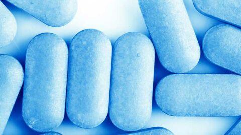 blue PrEP pills on white background