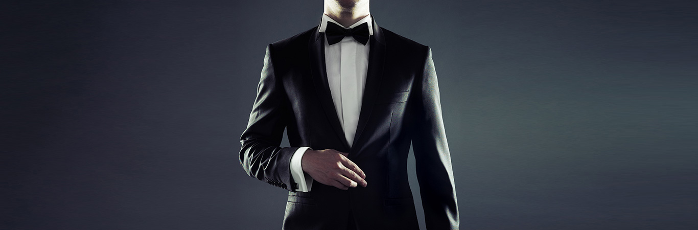 Man in dinner suit and bow tie ready for an extremely glamorous and elegant event