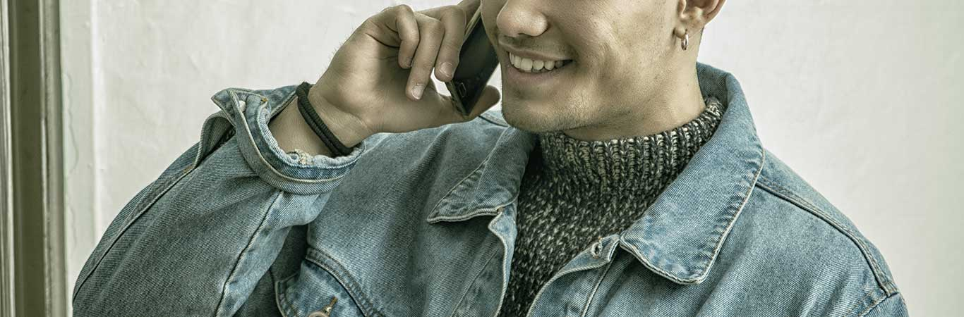 Smiling man on the phone