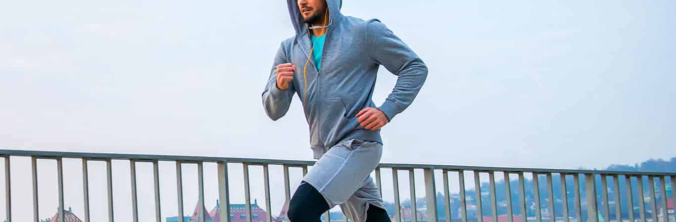 Man running with hoodie and skins