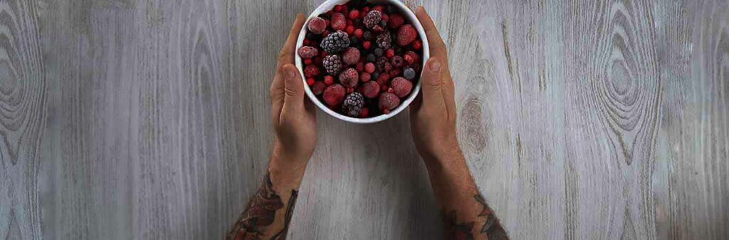 Man holding a bowl of berries