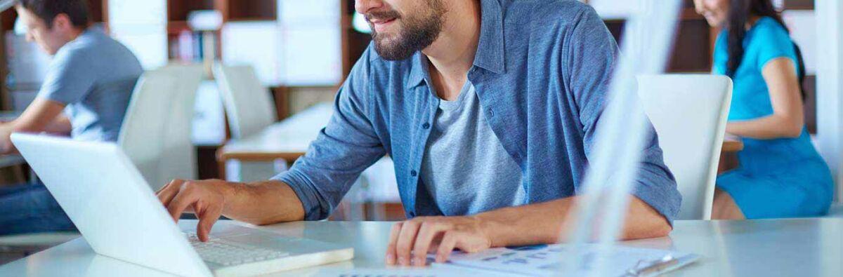 Man in blue shirt surfing the internet