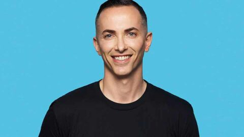 Smiling man on blue background supporting PrEP access for HIV prevention