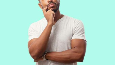 man with hand on face looking pensive