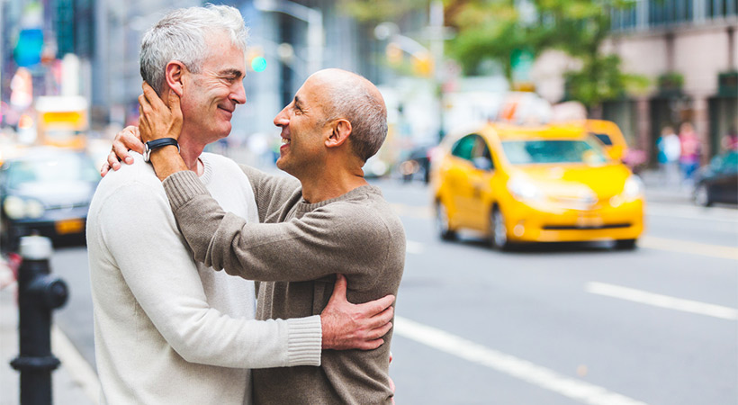 gay couple embrace on street