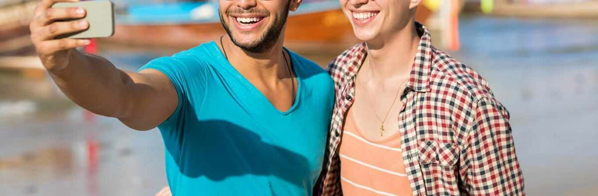 two guys on a date smiling and taking a selfie