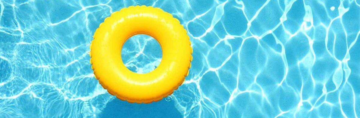 yellow inflatable rubber ring floating in swimming pool