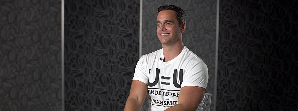 Karl Schmid wearing undetectable equals untransmittable tshirt