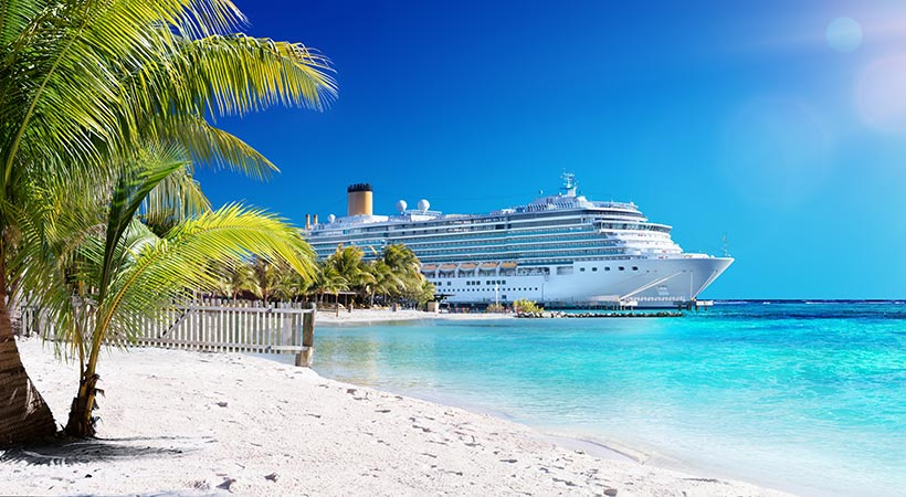 luxury cruise ship in port by the beach