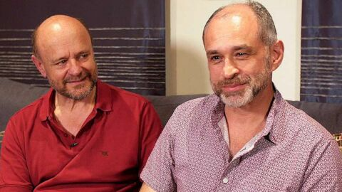 Gregory and Michael gay couple on sofa together