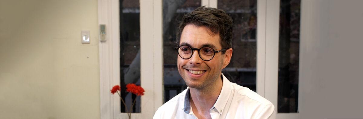 Doctor Vincent wearing glasses smiling