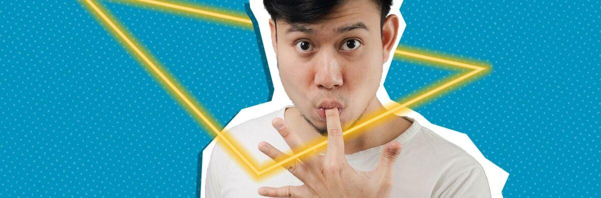 asian man looking ahead sucking his finger