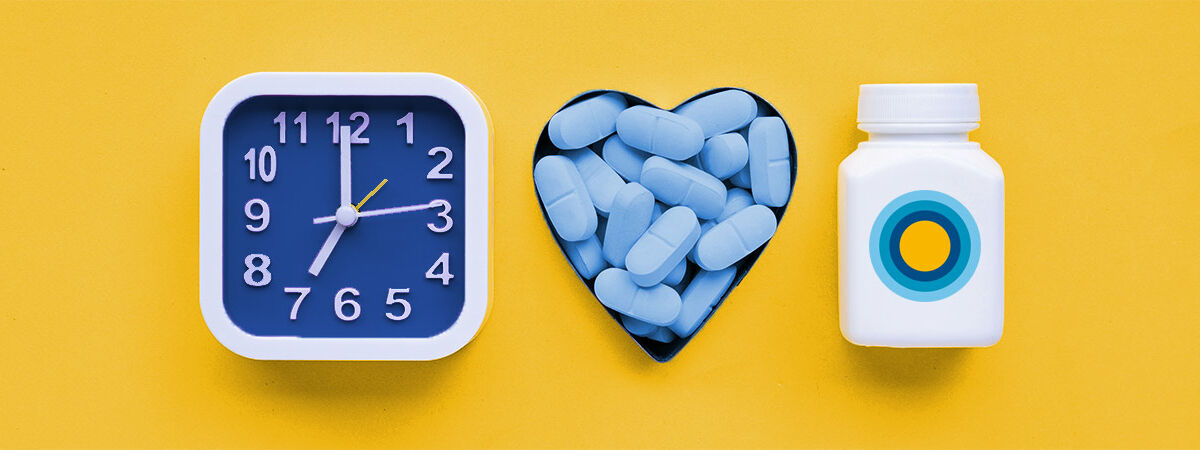 clock prep pills in heart shaped container pill bottle on yellow background