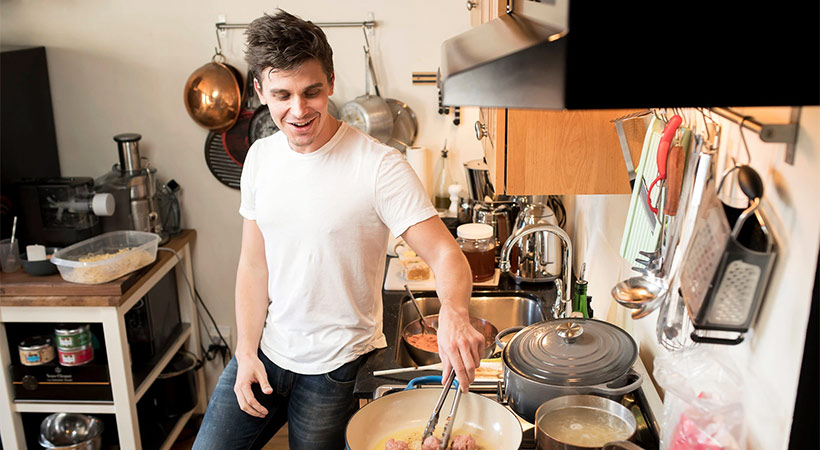 Antoni Porowski from queer eye cooking meatballs at home