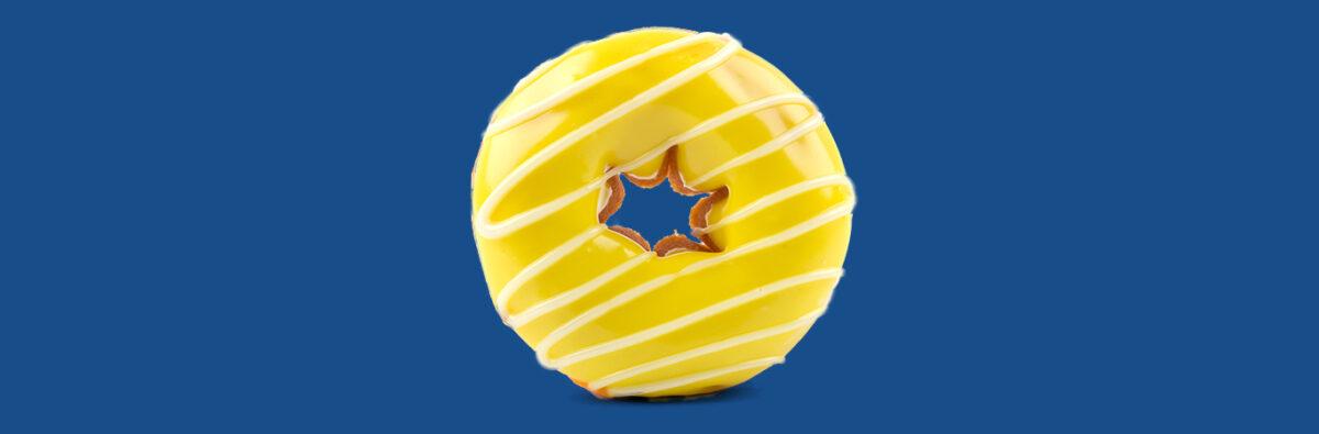 yellow glazed donut on blue background
